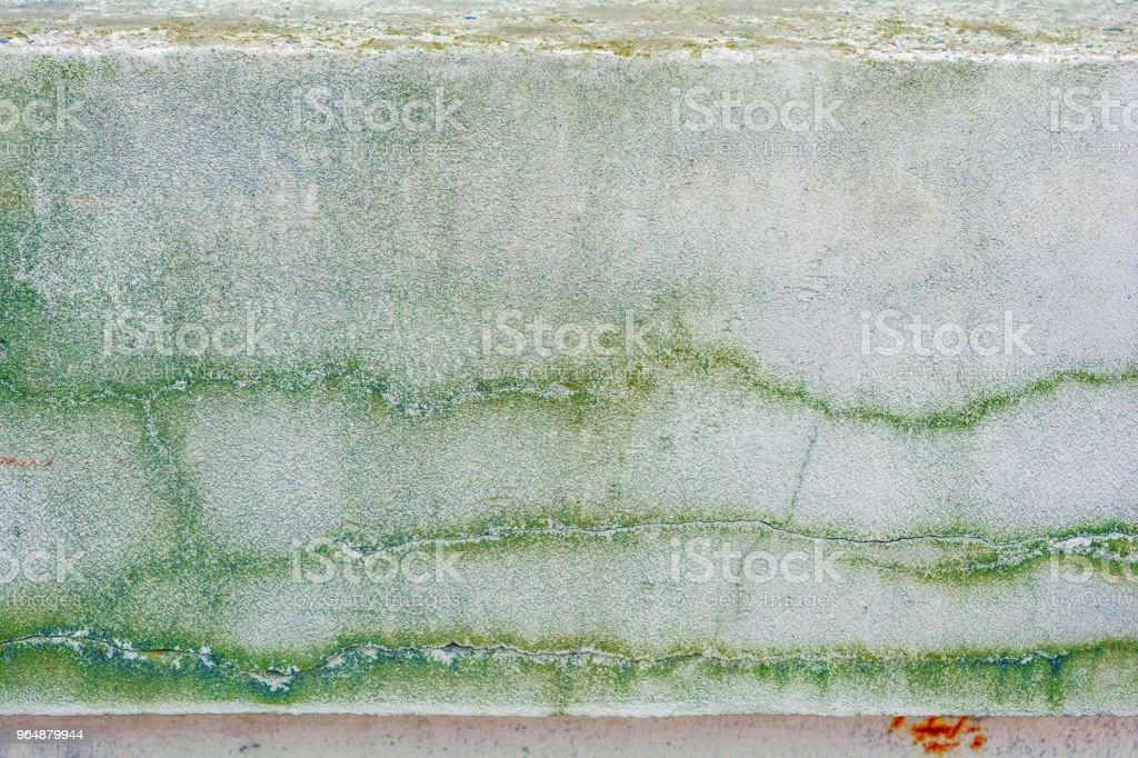 Old concrete wall with long cracks and moss royalty-free stock photo