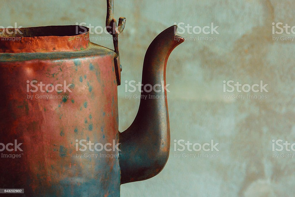 Old copper kettle stock photo