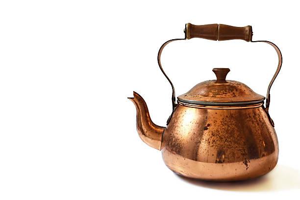 old copper teapot isolated on white background - keramikteekannen stock-fotos und bilder