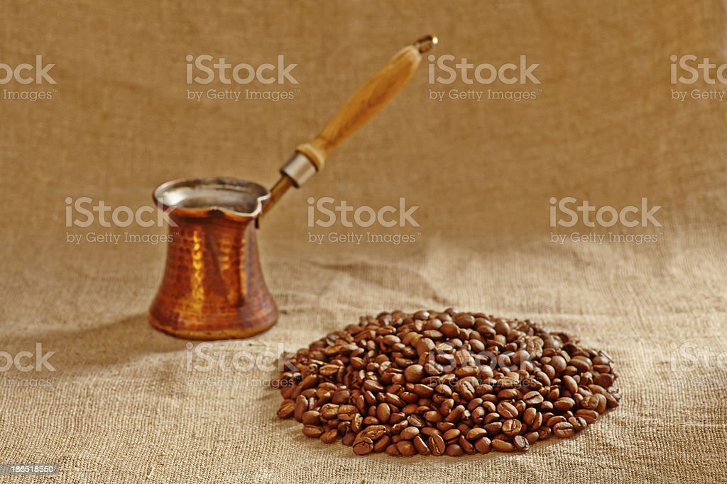Old copper turkish pot and coffee beans. Selective focus royalty-free stock photo