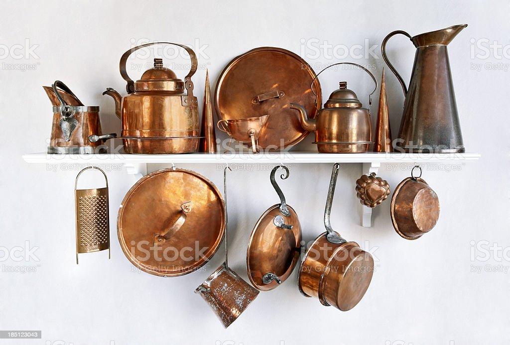 Old copper utensil on a shelf stock photo