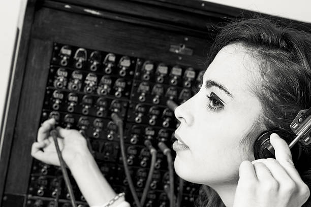 old cord switchboard operator - switchboard operator stock photos and pictures