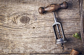 Old cork screw with space for text. Wine tasting background
