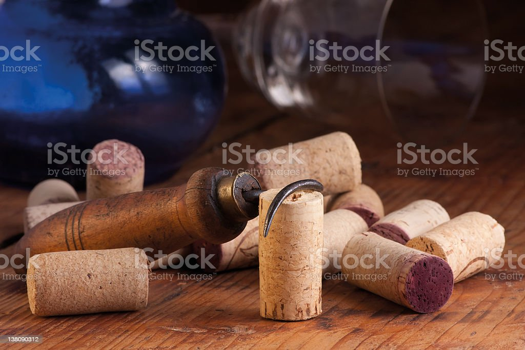 Old corkscrew and corks stock photo
