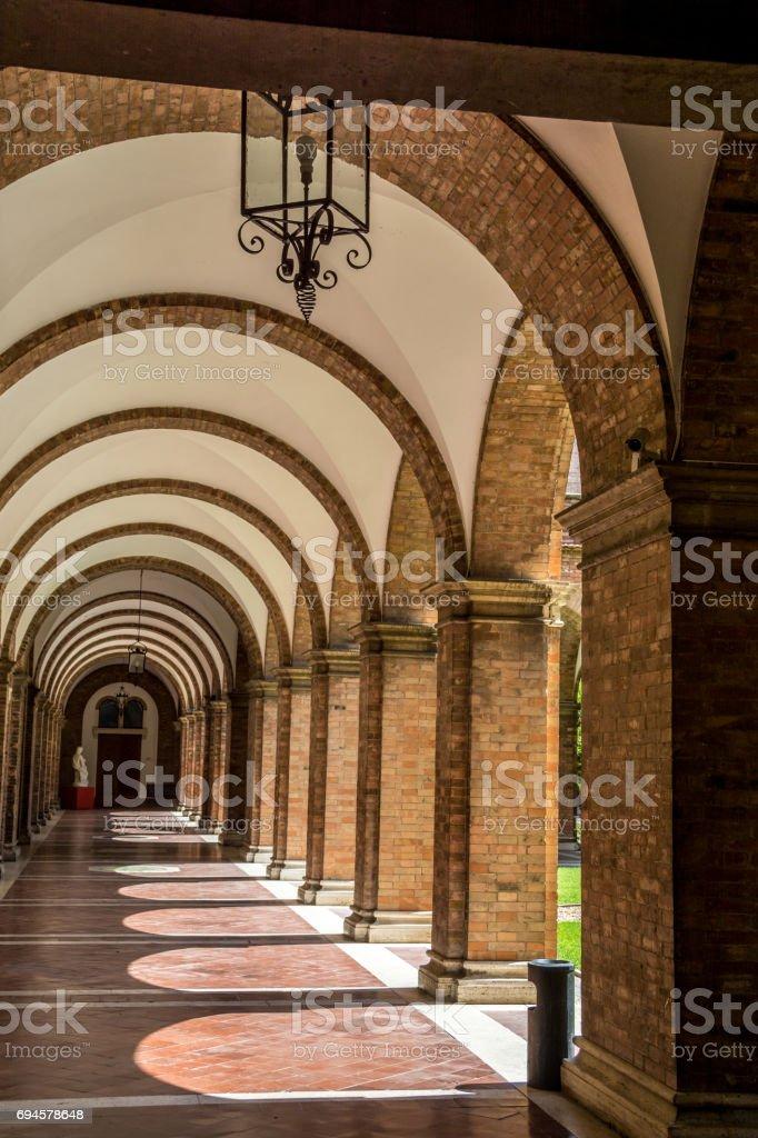 Old corridor with brick pillars stock photo