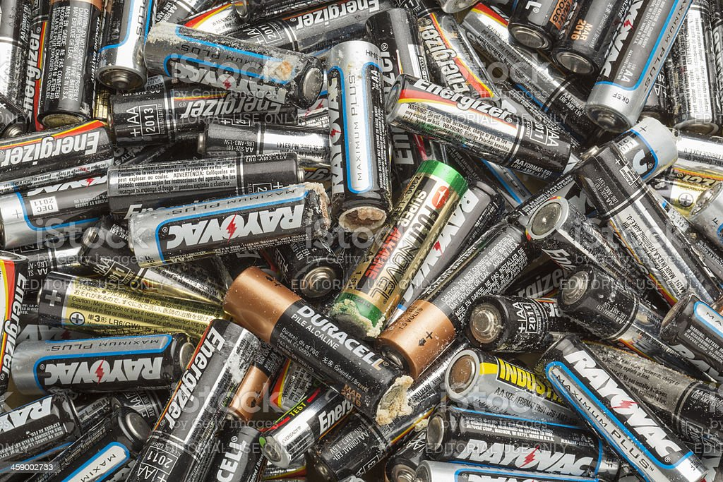 Old Corroded AA Size Batteries stock photo