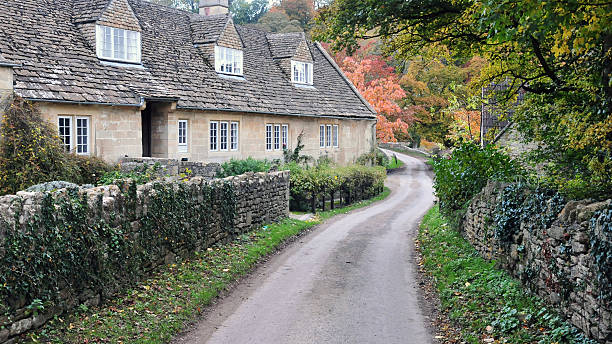 Old Cottage and Country Road stock photo