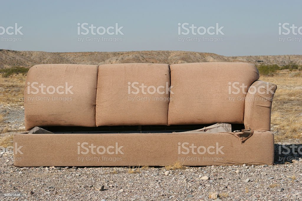 Old couch abondoned in desert
