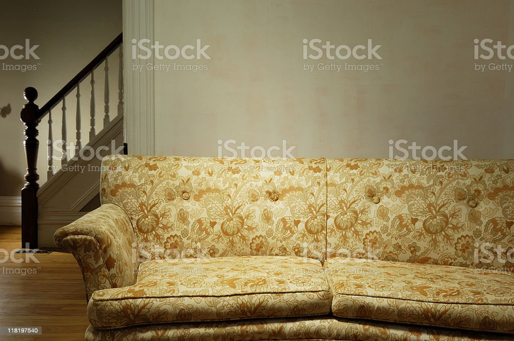 Old couch in a retro living room stock photo