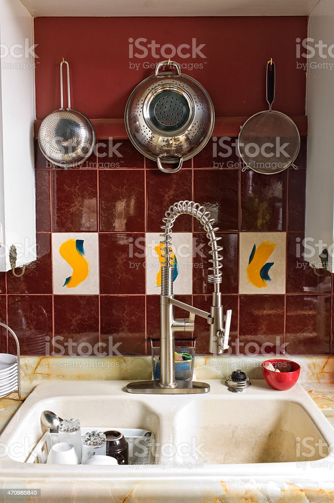 Old country home kitchen sink, dishes and strainers, collanders. stock photo