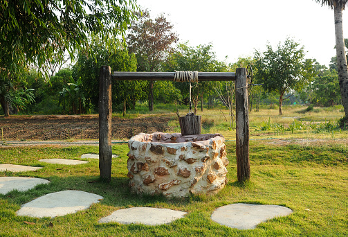 istock Old countryside water well. 517534790