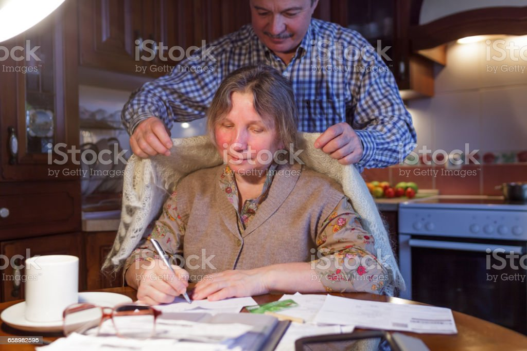 Old couple counting family money royalty-free stock photo
