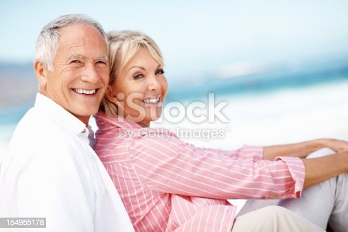452783143 istock photo Old couple enjoying their vacation on beach 154955178
