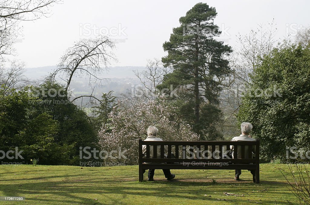 Old couple on a bench royalty-free stock photo