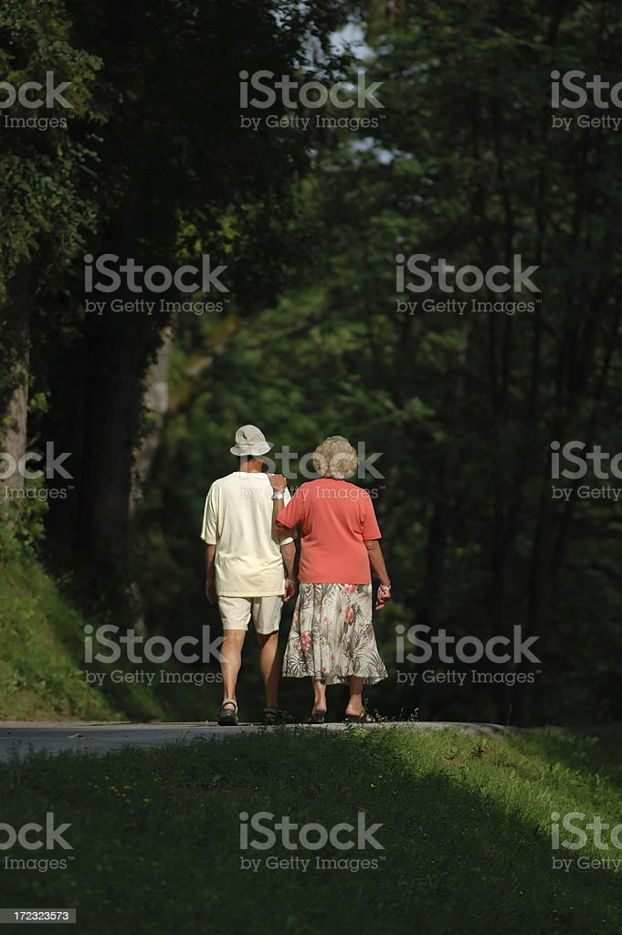 Old couple walking together royalty-free stock photo