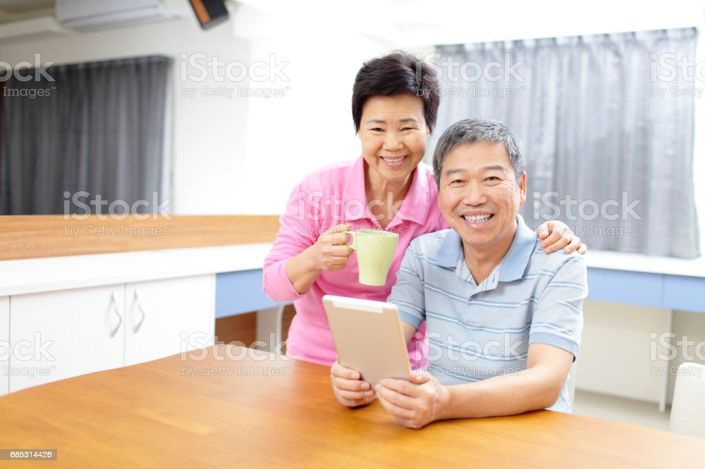 old couple with tablet foto de stock royalty-free