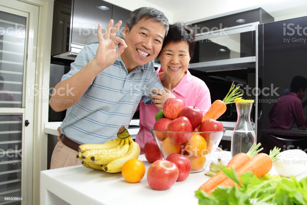old couple with vegetables foto de stock royalty-free