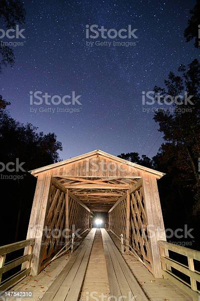 Photo of Old Covered Bridge at Night in the Country