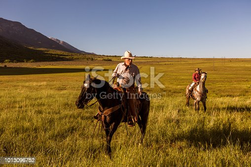Old cowboy and daughter on horse at santaquin valley of Salt lake City SLC Utah USA