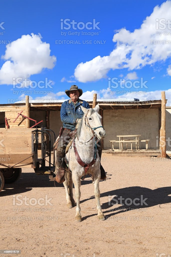 Old cowboy and his horse royalty-free stock photo