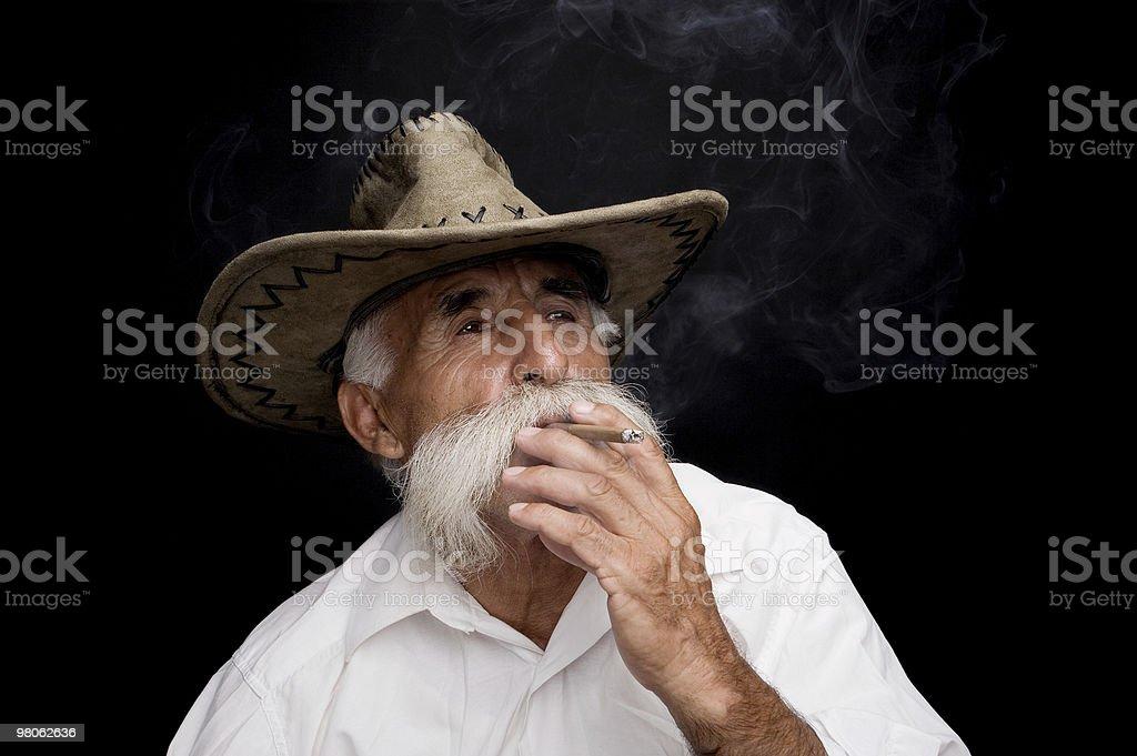 Old cowboy smoking royalty-free stock photo