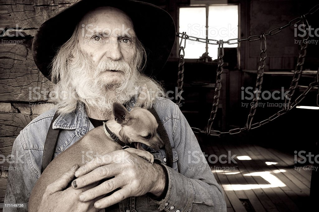 Old Cowboy with his Dog stock photo