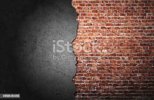 istock Old cracked brick wall 499848456