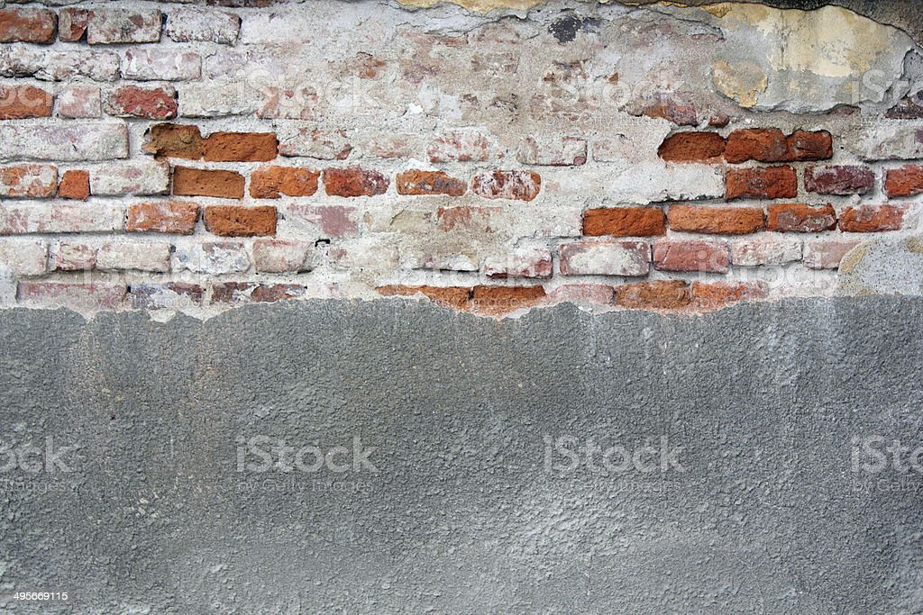 old cracked wall with cement and bricks stock photo