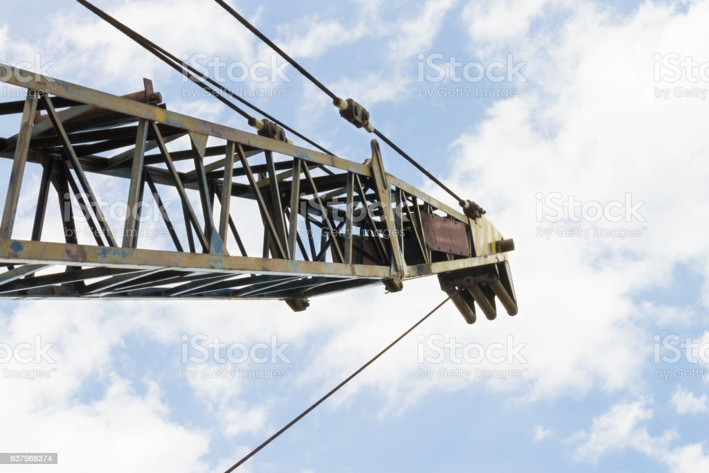 Old Crane or Metal Structure and Sling on Blue Sky Background stock photo