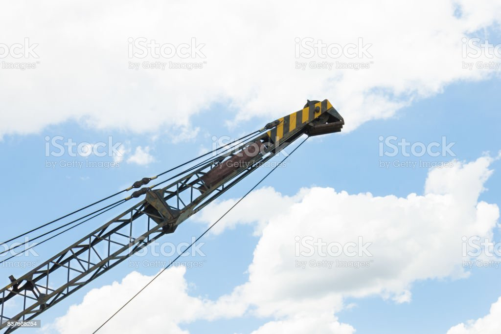 Old Crane or Metal Structure and Sling on Blue Sky Background Side View stock photo