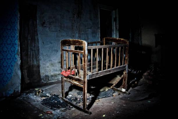 old-creepy-eerie-wooden-baby-crib-in-aba