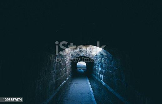 istock Old creepy underground stone tunnel. Halloween Locations 1056387674