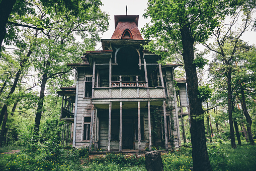 Old creepy wooden abandoned haunted mansion