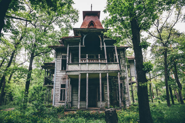 Old creepy wooden abandoned haunted mansion stock photo