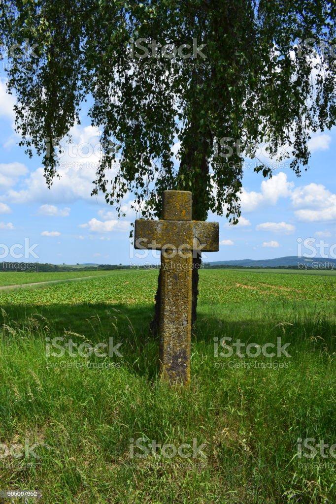 old cross from vulcanic stone zbiór zdjęć royalty-free