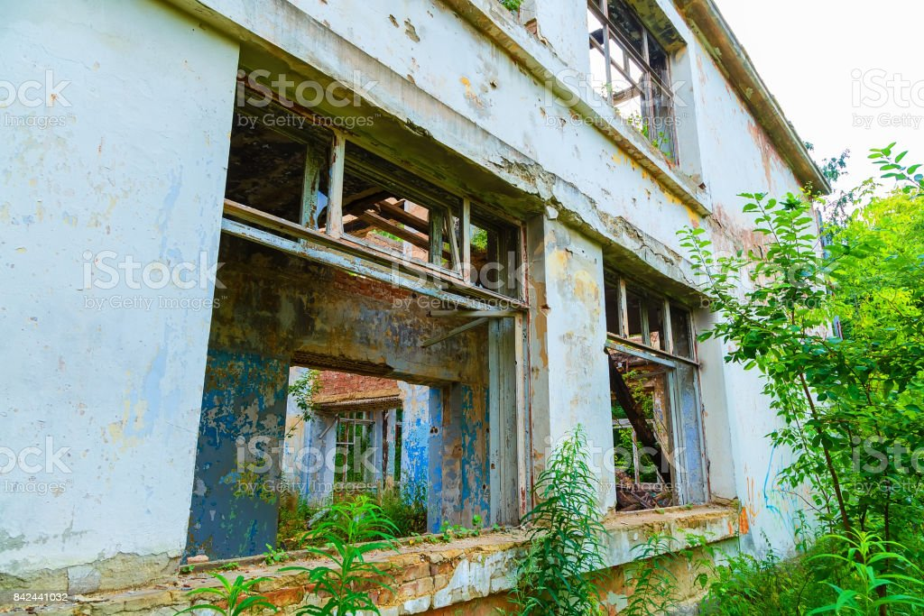 Old crumbling brick house, abandoned building background. stock photo