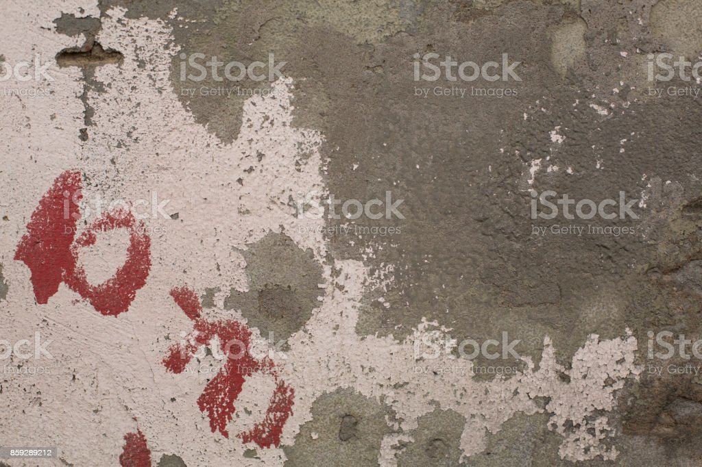 Old crumbling paint on gray plaster concrete wall texture royalty-free stock photo