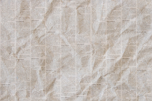 Old crumpled newspaper texture background
