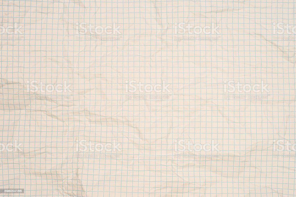 Old crumpled squared paper (as a background) stock photo