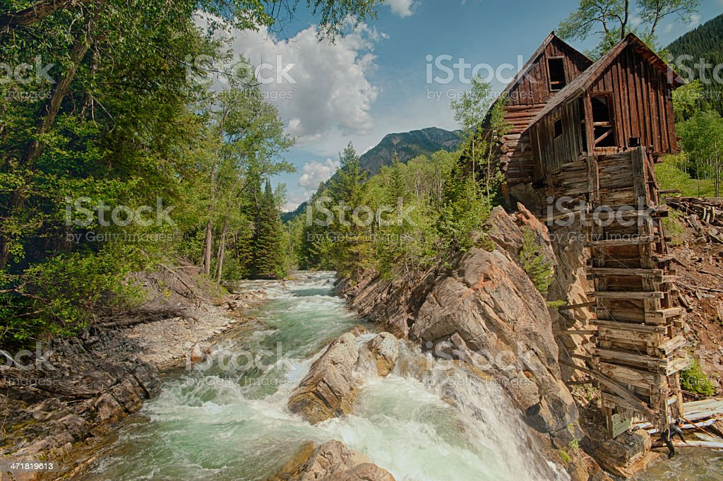Old Crystal Mill on the river in Colorado stock photo