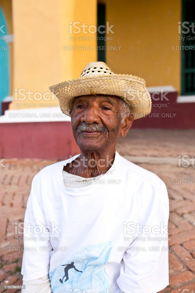 Old Cuban Man In The Backstreets Of Trinidad Stock Photo