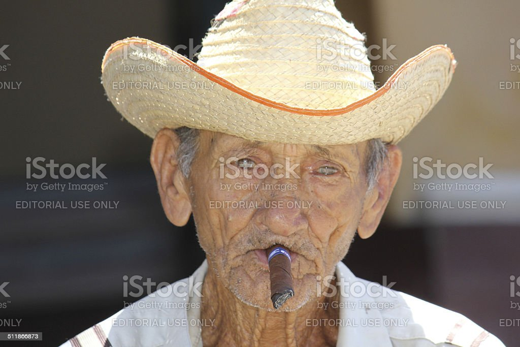Old cuban man smoking a  cigar. stock photo