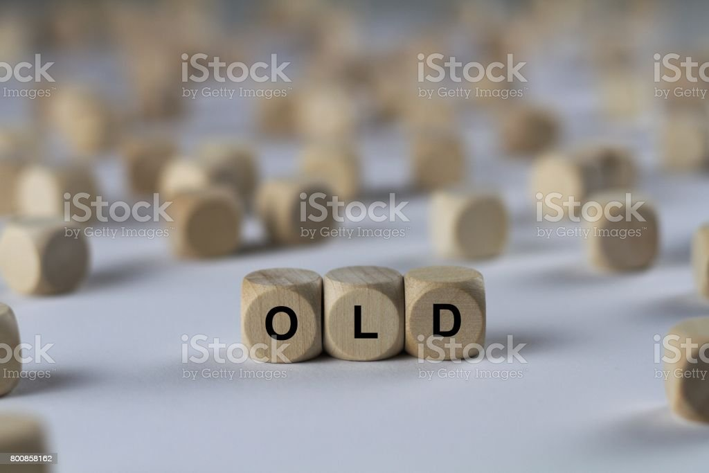 old - cube with letters, sign with wooden cubes stock photo