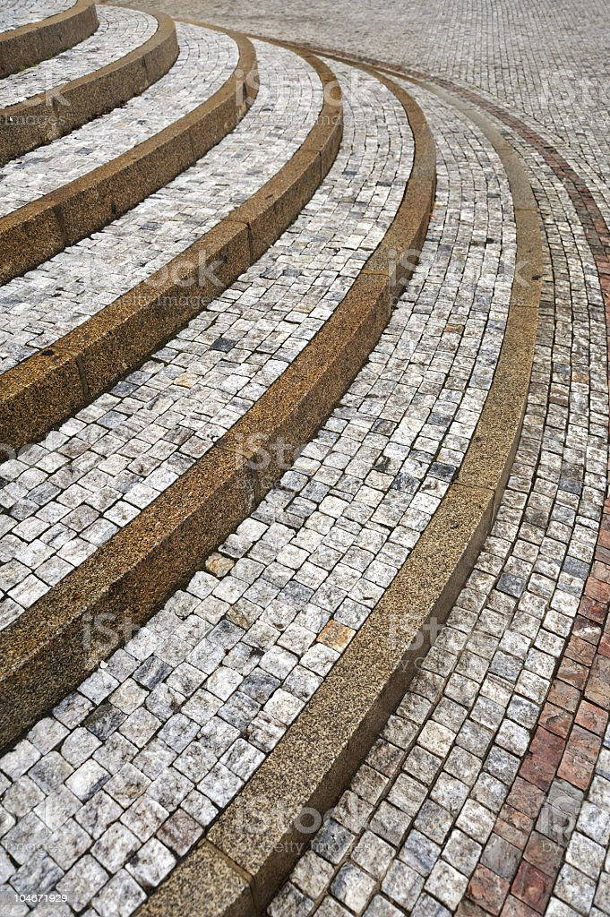 Old curved stone steps - cobblestones royalty-free stock photo