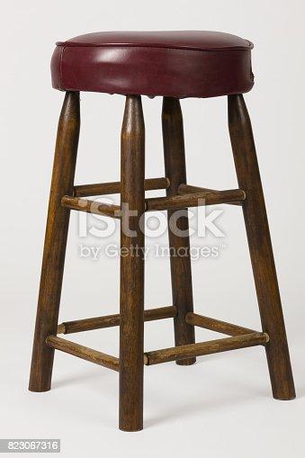 istock Old Cushioned Bar Stool 823067316