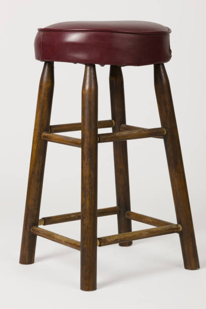 Old Cushioned Bar Stool Have you seen this great old bar stool type chair? Shot on a plain white background. Maybe a seat for a comic or a great place for some fruit? Who knows? Really, you can decide what goes there. Buy freedom. stool stock pictures, royalty-free photos & images