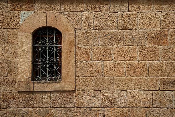 old cut stone wall and window - adomer stok fotoğraflar ve resimler