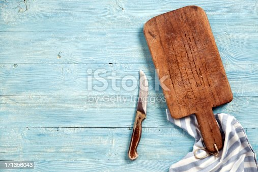 istock Old cutting board and knife 171356043