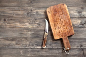 istock Old cutting board and knife 171361152