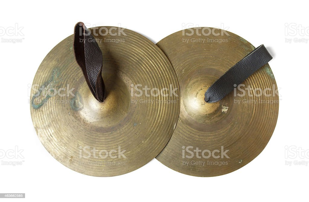 Old cymbals with leather handheld stock photo